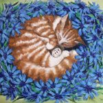 Sweet dreams. A ginger cat sleeping in cornflowers