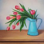 Pink tulips in blue jug